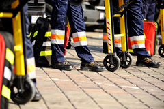 Ambulance personnel. Feet are seen next to emergency equipment stock photo