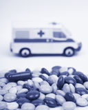 Ambulance and pills Royalty Free Stock Photo