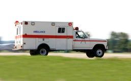 Ambulance pilotant rapidement Photos stock