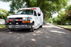 Ambulance in Residential Area Stock Photo