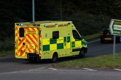 Ambulance in rush on the street. Watford, UK - October 5, 2017: Ambulance in rush on the street in the town stock photo