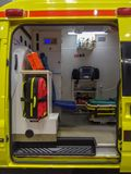 Ambulance side door opening and interior details. Ambulance interior details view from side door. Emergency and resuscitation equipment and devices visible stock photos