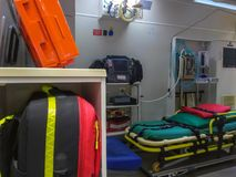 Ambulance side door opening and interior details. Ambulance interior details view from side door. Emergency and resuscitation equipment and devices visible stock photo