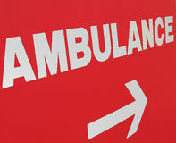 Ambulance sign to emergency room. Red and white sign with arrow pointing the way to a hospital emergency room Royalty Free Stock Image