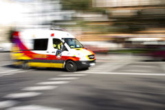 Ambulance. Speeding through the street at daytime stock image