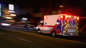 Fast speeding ambulance stock photography