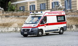 Ambulance in the square of the people in first aid Royalty Free Stock Images