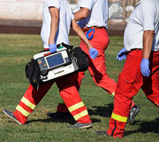 Ambulance staff with medical equipments Stock Image