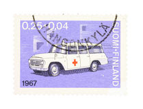Ambulance on a stamp. Collectible old stamp from Finland. Stamp with vintage ambulance car Stock Image