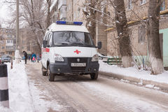 An ambulance stands in the courtyard of a multistory building Royalty Free Stock Image
