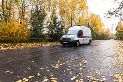 Ambulance at the street in autumn. In a rainy day Stock Photos