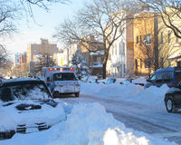 Ambulance on the street after blizzard Stock Images