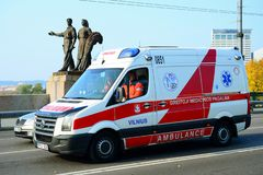 Ambulance team in Vilnius city over the green bridge Stock Photography