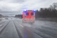Ambulance van on highway in Germany stock image