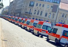 Ambulances. Many ambulances in a queue in the street Royalty Free Stock Photography