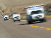 Ambulances rushing. Down the highway Stock Photo