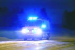 Ambulancia en la noche azul Imágenes de archivo libres de regalías