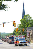 Ambulansbrandlastbilen ståtar arkivfoto