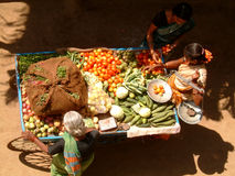 Ambulant vegetable stall. Lady selling her vegetables on her ambulant stall Stock Photos