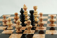 Ambushed chess king and queen Royalty Free Stock Photography