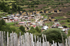 Amdo farmers traditional village. Typical village in the foothills of Tibet, barley and corn dryer, wood fence Stock Photo