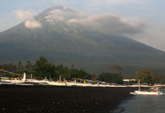 Ganung Angun Volcano and Black Sand Beach Stock Photo