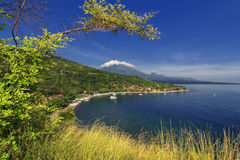 Amed beach Bali with Mountain Agung and Blue sky Stock Images