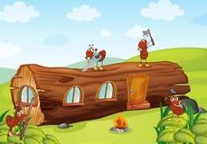 Ameisen und hölzernes Haus Stockfoto