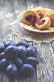 Ameixas e bolinhas de massa da ameixa Fotografia de Stock