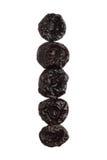 Ameixas secadas isoladas sobre o fundo branco, fim acima Imagens de Stock Royalty Free