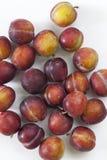 Ameixas secas do vermelho e do amarelo Fotografia de Stock Royalty Free