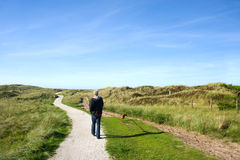 Ameland walking the dog Royalty Free Stock Images