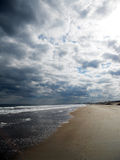 Amelia Island, Florida beach. Shoreline. White sand, clouds, and waves stock photo