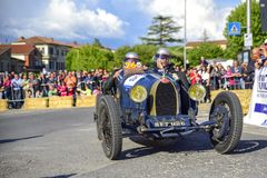 Amelia, Italy, May 2018. Mille Miglia 1000 Miles, historical vintage car race. Two men driving a historic Bugatti, blue color. stock photo