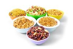 Amendoim, chole e nimko em umas bacias Fotografia de Stock Royalty Free