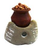 Amendoim com fogão da argila Imagens de Stock