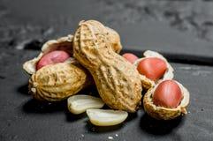 Amendoins com shell fotos de stock