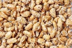 Amendoins doces com sésamo Imagens de Stock Royalty Free