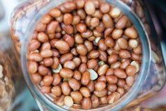 Amendoins em um frasco Imagens de Stock Royalty Free