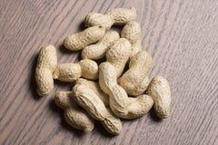 Amendoins, fundo dos amendoins Semente dos amendoins Textura dos amendoins da vinheta Amendoim de Brown Material do amendoim foto de stock royalty free