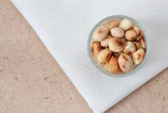Amendoins na chita e de madeira Imagens de Stock Royalty Free
