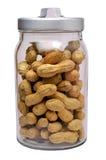 Amendoins no frasco de vidro imagens de stock royalty free