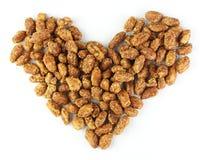 Amendoins roasted cobertos açúcar, coração Fotos de Stock Royalty Free
