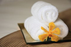 Amenities. Towel and Orchid in a 5 star wellness resort Stock Image