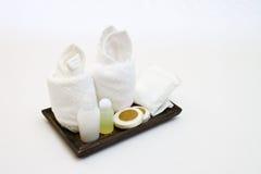 Amenities kit. Hotel amenities kit on wooden tray Royalty Free Stock Photo