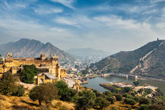 Amer aka Amber fort, Rajasthan, India. Indian travel famous tourist landmark - view of Amer (Amber) fort and Maota lake, Rajasthan, India Royalty Free Stock Photography