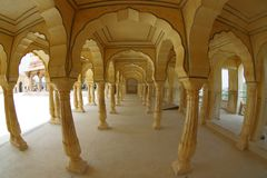 Amer, India - September 19, 2017: Collumned yellow hall in Sattais Katcheri in Amber Fort near Jaipur, Rajasthan, India Royalty Free Stock Photo