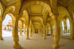 Amer, India - September 19, 2017: Collumned yellow hall in Sattais Katcheri in Amber Fort near Jaipur, Rajasthan, India Stock Photos