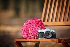 Сamera and wedding bouquet Royalty Free Stock Photos