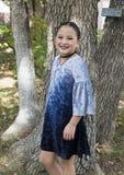 Amerasian girl posing in the trees in Oklahoma City, Oklahoma Stock Photo